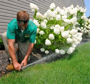 Irrigation specialist Shane Chaney adjusts coverage on an Ever-Green installation.